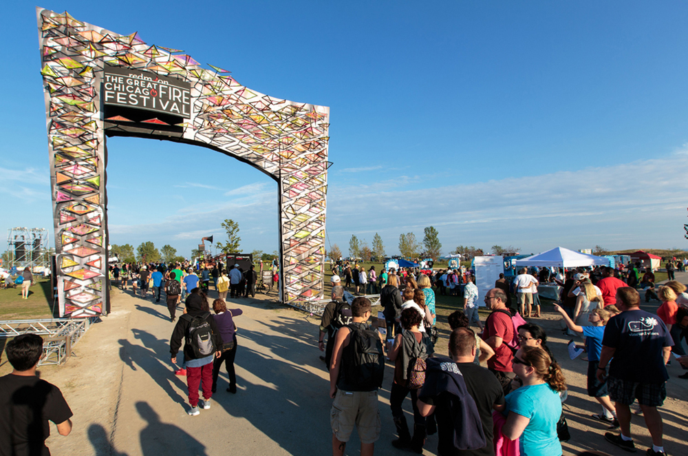 The Archway - The Great Chicago Fire Festival on Northerly Island     with Redmoon & After School Matters | Chicago, IL [2015]   Youth created a multitude of geometrically woven panels that were then suspended from a 20' tall by 20' wide pre-fab aluminum trussed arch.  The brightly colored panels flowed over the arch's surface in a flame-like movement atop black and white portraits of the participants. The students worked both independently as well as collaboratively to explore various techniques in string art.
