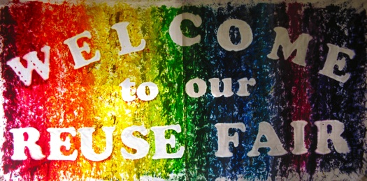 Reuse Fair sign is made from two used tablecloths and used crayons