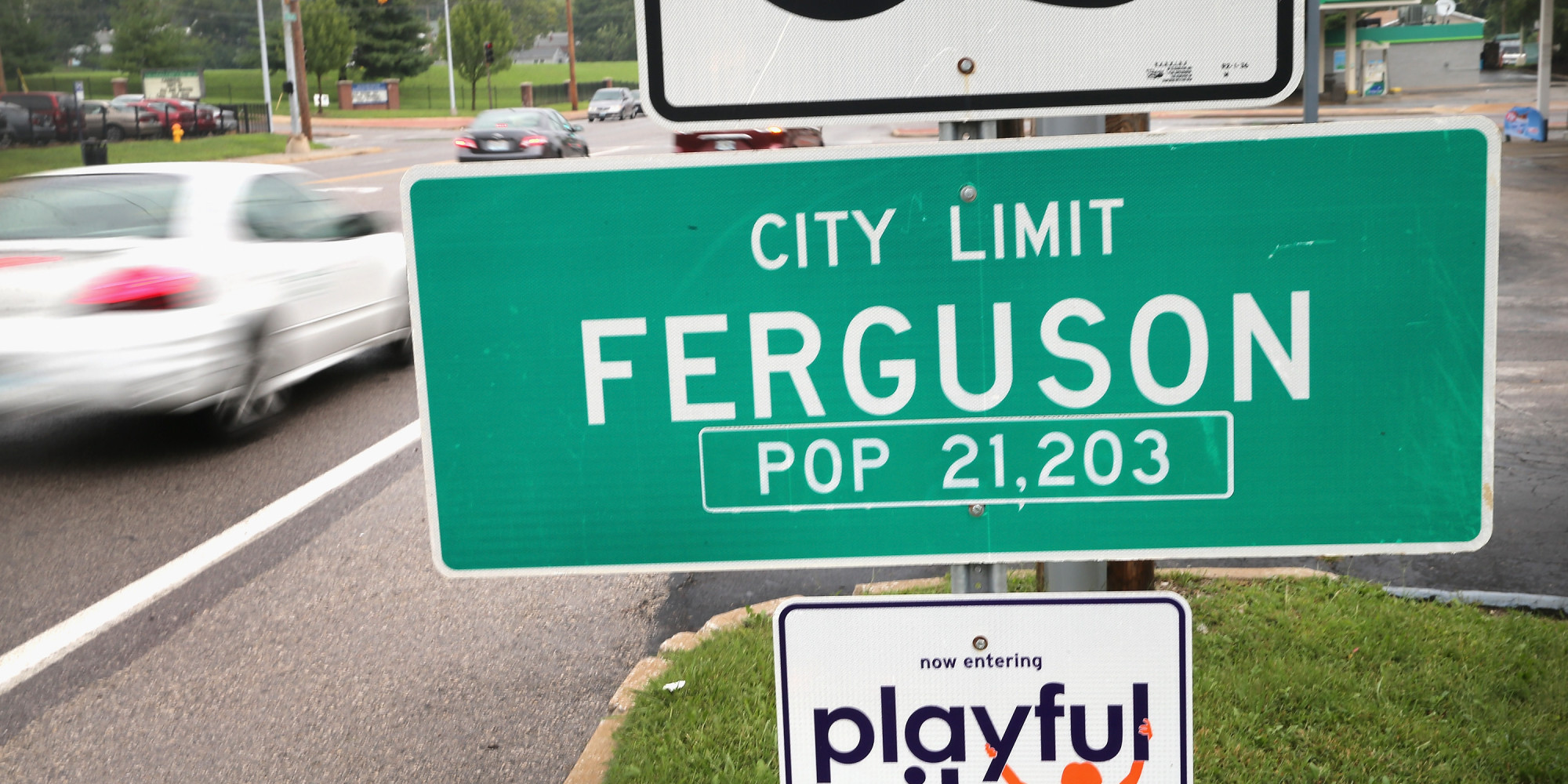 FERGUSON, MO - SEPTEMBER 10: A sign welcomes visitors to the city on September 10, 2014 in Ferguson, Missouri. The suburban St. Louis city is still recovering from violent protests that erupted after teenager Michael Brown was shot and killed by Ferguson police officer Darren Wilson about a month ago. (Photo by Scott Olson/Getty Images)