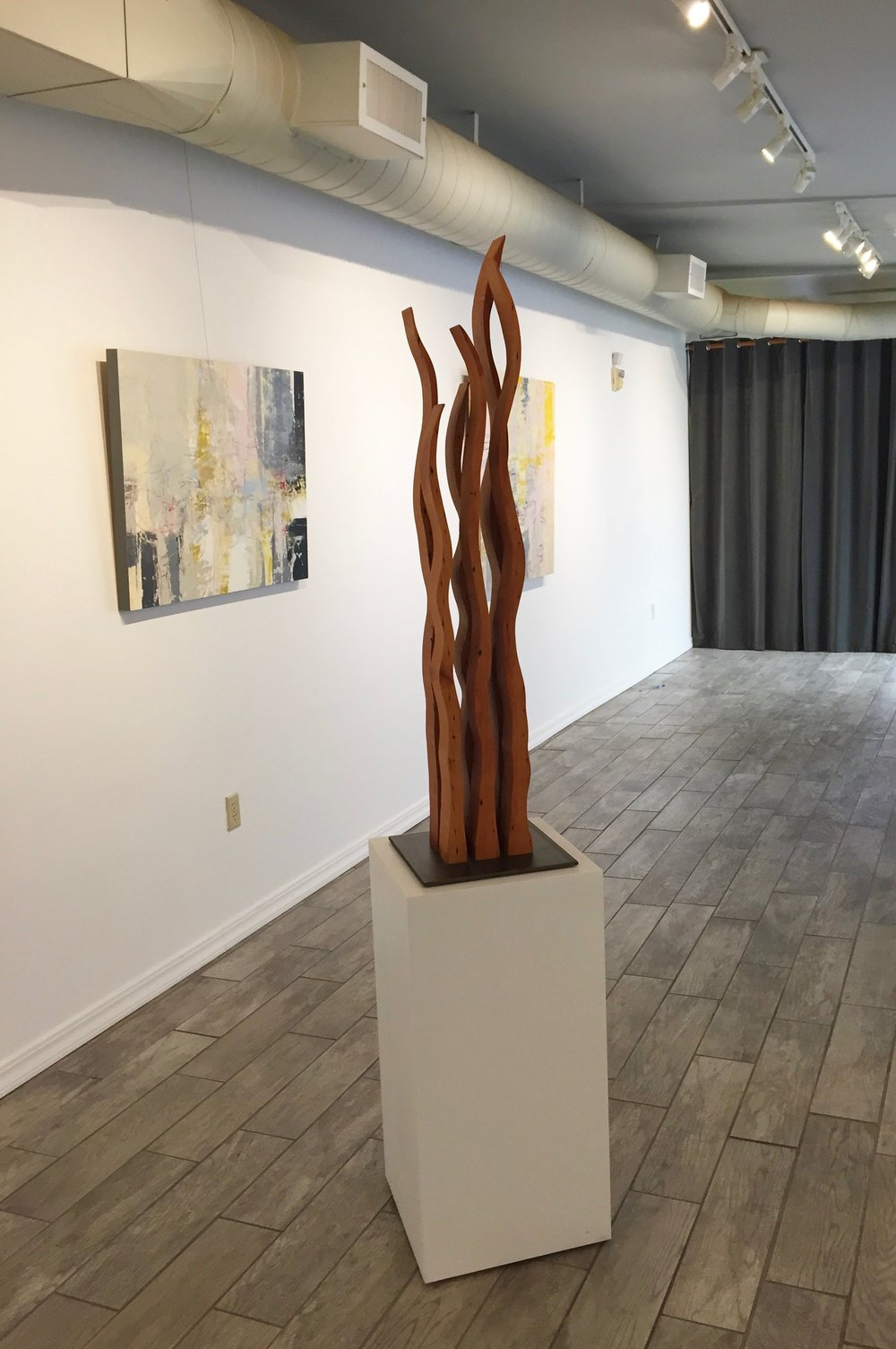 "Contemporary sculpture ""Dancing Flames"" made from reclaimed wood at Desta Gallery in San Anselmo"