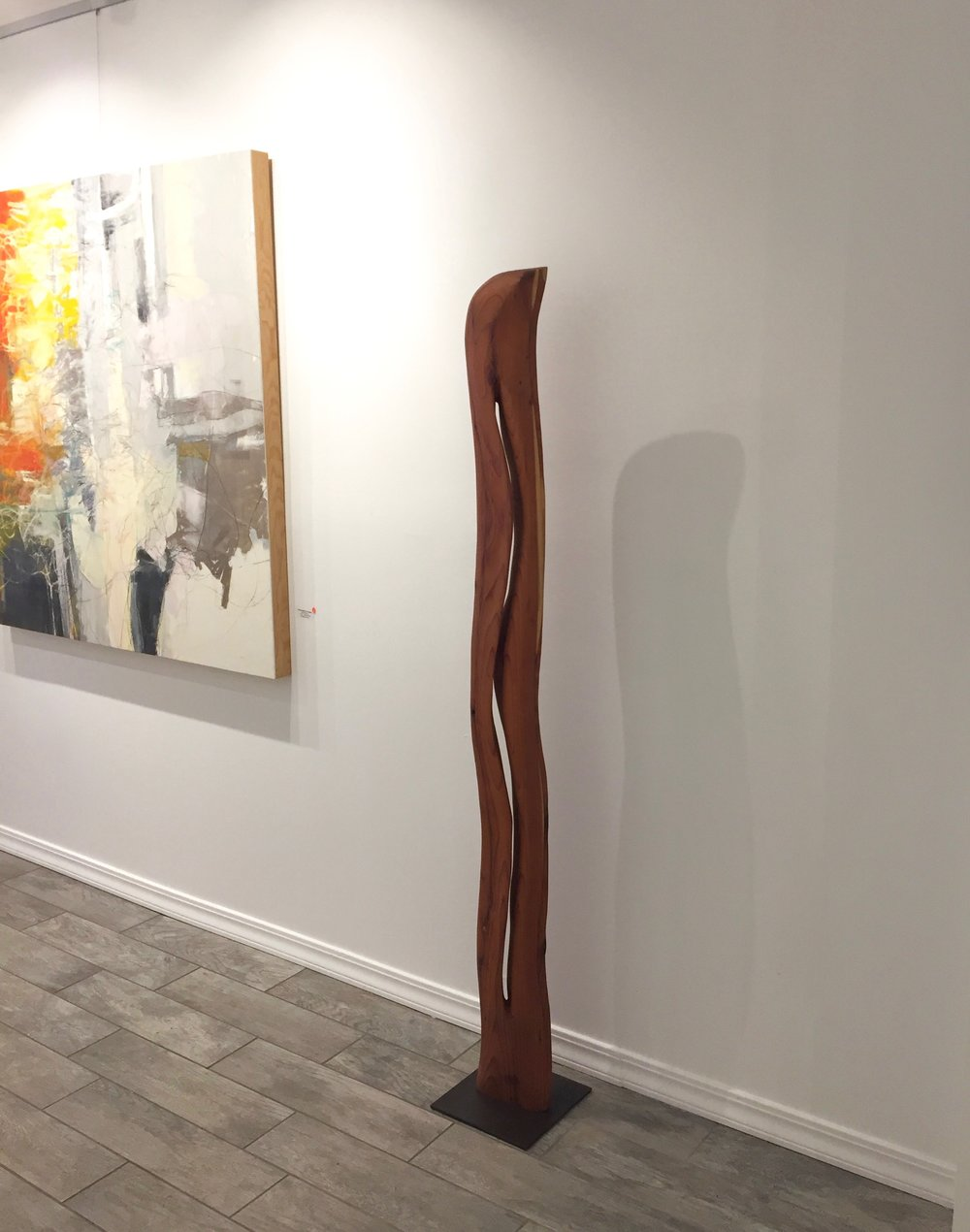 "Wood sculpture ""Elegance II"" made from reclaimed redwood at Desta Gallery in Anselmo"