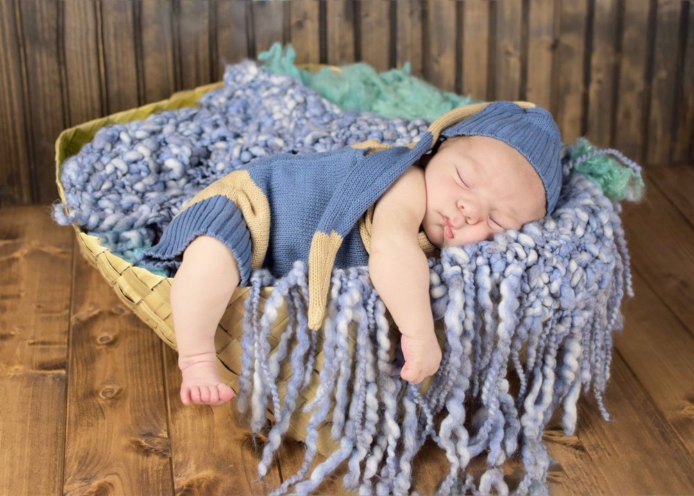 Newborn Boy Session done in home outfit upcycled from a sweeter and blue basket layer both made by Mindful Light Photography