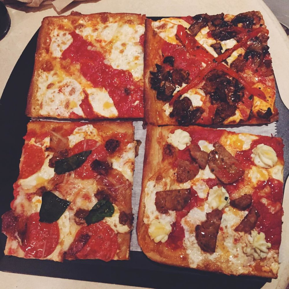 Going to town on some squares from L'inizio in Long Island City.  Of course with Mike's Hot Honey all over them.  🍕          #queenscravings #notallmine #queens #longislandcity #food #licfood #eeeeeats #queenseats #queensnyc #heartofqueens @liniziopizzabar @mikeshothoney  (at L'inizio Pizza Bar)