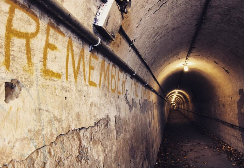 """Remember the Maine."" Apparently the original text from the late 1800s (although it has been touched up over the years by the Parks Department) in the tunnels at Fort Totten.  Times have changed but we continue to remember those tragically lost."