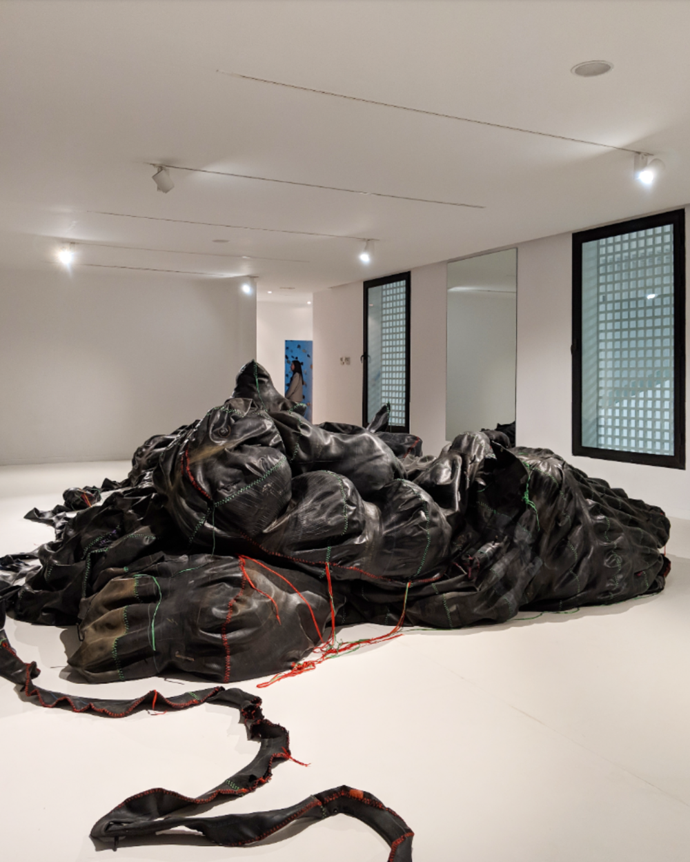 Nicholas Hlobo,  Tyaphaka  (2012), rubber tire, hosepipe, ribbon.