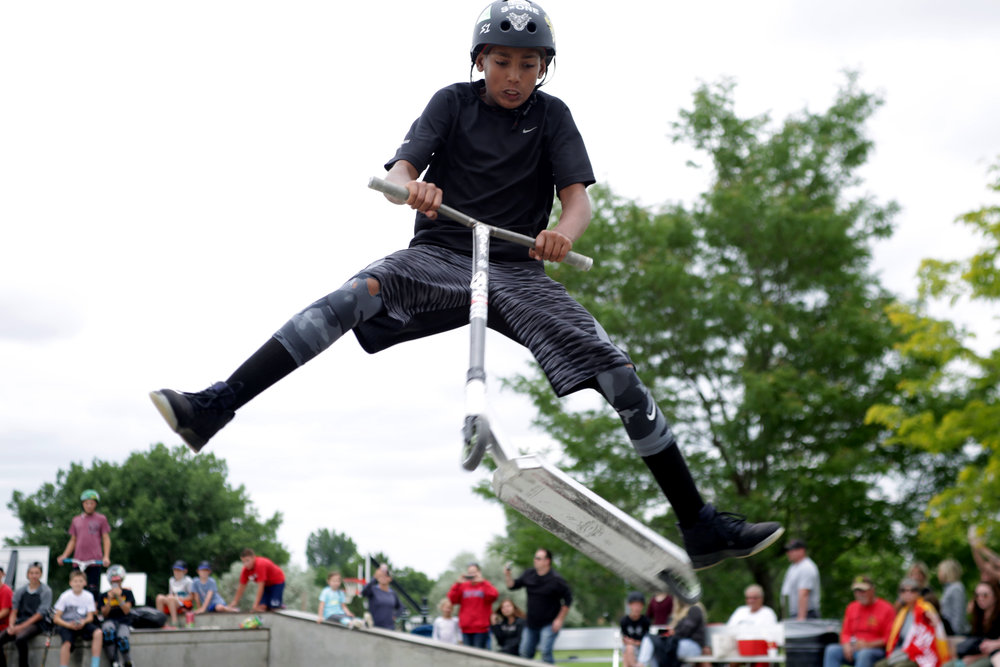 Terrick Wilkins 13, jumps over the ledge of a bowl at the Windsor, Colorado, Grind scooter and skateboarding competition, June 2017. The Windsor Grind was a joint effort put together by the Windsor Clearview Library District and Windsor Parks Recreation and Culture Department (Greeley Tribune Newspaper).