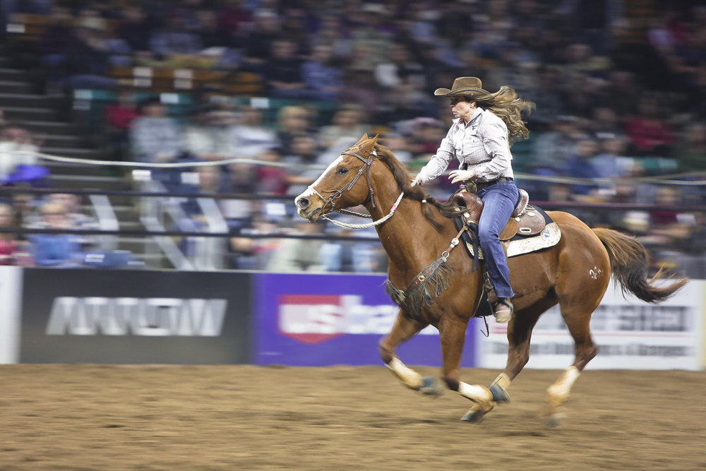 A cowgirl rides her horse during a barrel race at the National Western Stock show in Denver, Colorado, in January 2018.