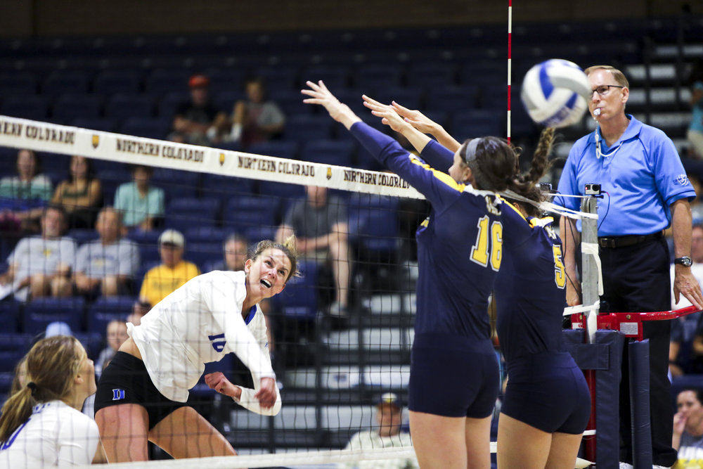 Duke University's Cadie Bates spikes the ball over University of Colorado's block during a volleyball game on Saturday at the Bank of Colorado Arena in Greeley, Colorado.