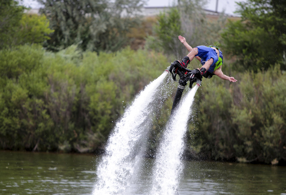 Chris Hock does a backflip on a fly board during the Bridge the Gap wakeboard and waterski tournament on Saturday at Madison Lake in Greeley, Colorado. The purpose of the event was to honor Scott Barone a wakeboarder who passed away. Additionally the event was sponsored by Tommy's Colorado, a water sports retailer and the event hosted many types of water sports.