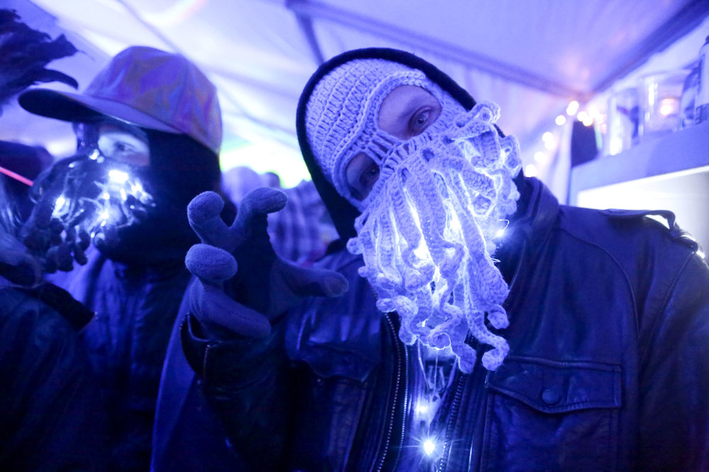 People with handmade masks pose at Frozen Dead Guy Days (FDGD) festival in Nederland, Colorado, on March 9, 2018. FDGD is a music festival that started in 2002 and is an annual occurrence that celebrates the discovery of the cryonic state corpse of Bredo Morstoel.
