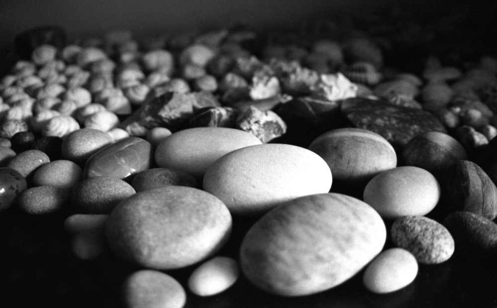 Michael Grab, 31, a stone balancing artist, collects rocks from all around the world and displays them in his room in Littleton, Colorado, April 2016. Each of these rocks holds significance to Grab's life as a memory for each place he has traveled.