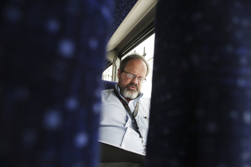 Kevin Pettit, 50, reviews his script for a Romeo and Juliet play on the bus ride to the Denver Arts Center on April 5, 2018. Ever since Pettit's accident he has chosen not to drive again.