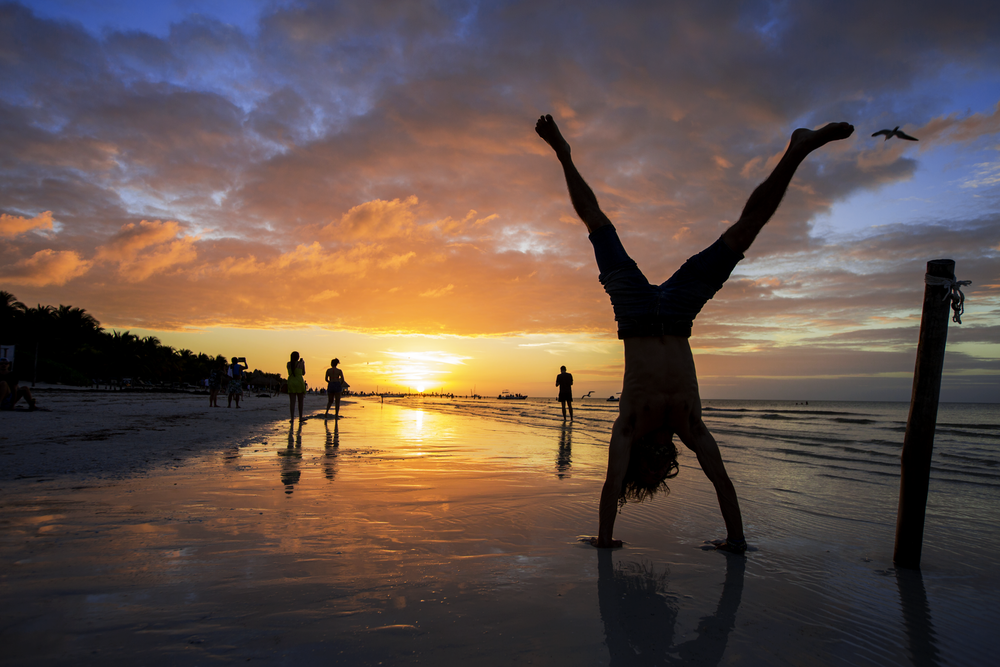 Jason Gegere does a handstand as the sun sets in Isla Holbox, an island north of Mexico's Yucatán Peninsula, on December 29, 2018.