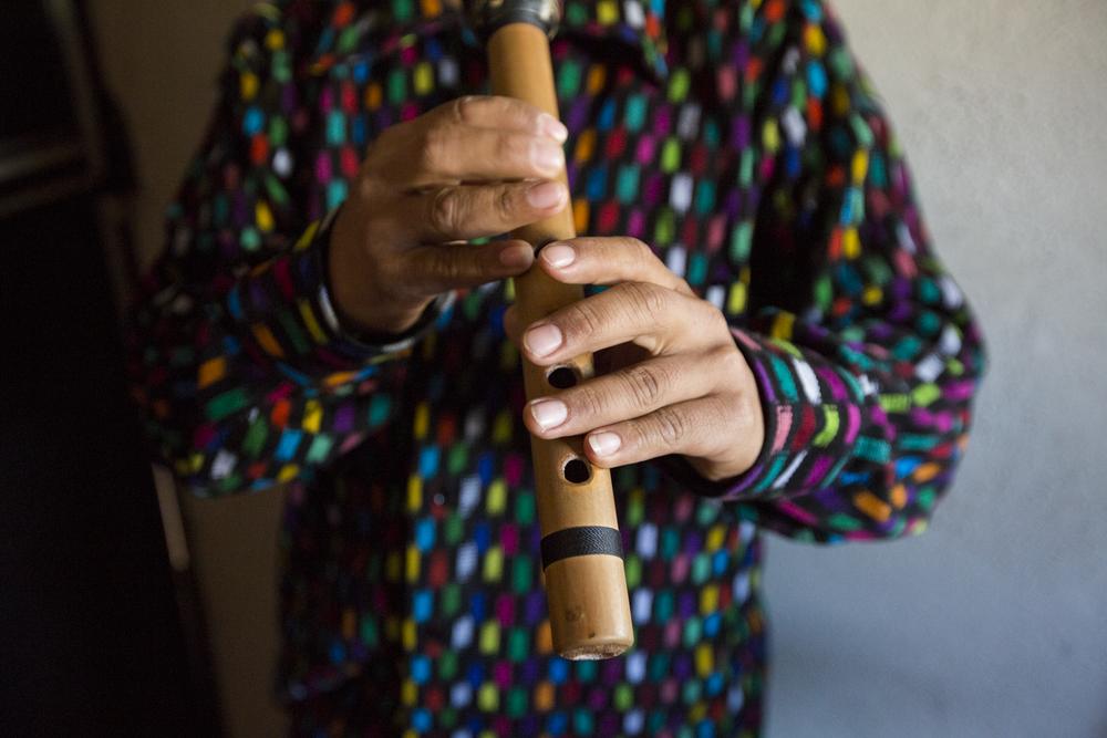 Pedro Quick 23, a close friend of Mendoza, plays the flute in San Juan La Laguna on December 22, 2018.