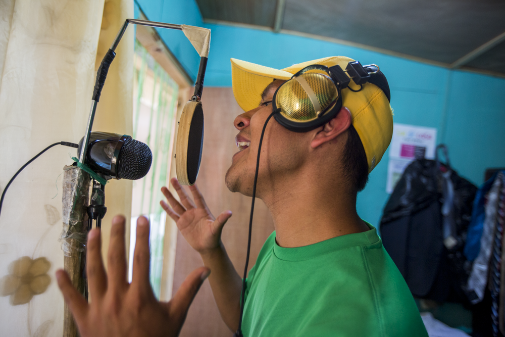 Jasy Mendoza, 23, member of Poesía Loca, records a song in his house in San Juan La Laguna, Lake Atitlán on December 22, 2018. Mendoza made his recording studio in his room but also often practices in his producers' studio or the central park of San Juan La Laguna.