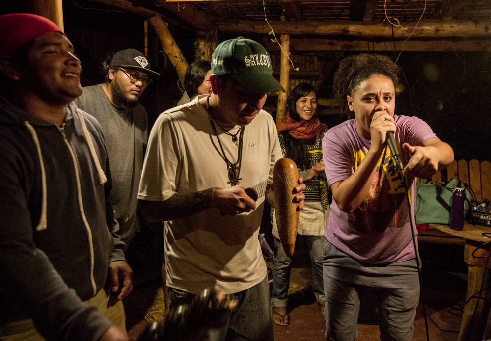 """Angelique """"Giddy"""" Perez, raps during a freestyle event in San Marcos La Laguna, Lake Atitlán on November 26, 2018. Giddy is an international touring spoken-word poet, MC, beatboxer, and barber who is apart of the Next Level initiative."""