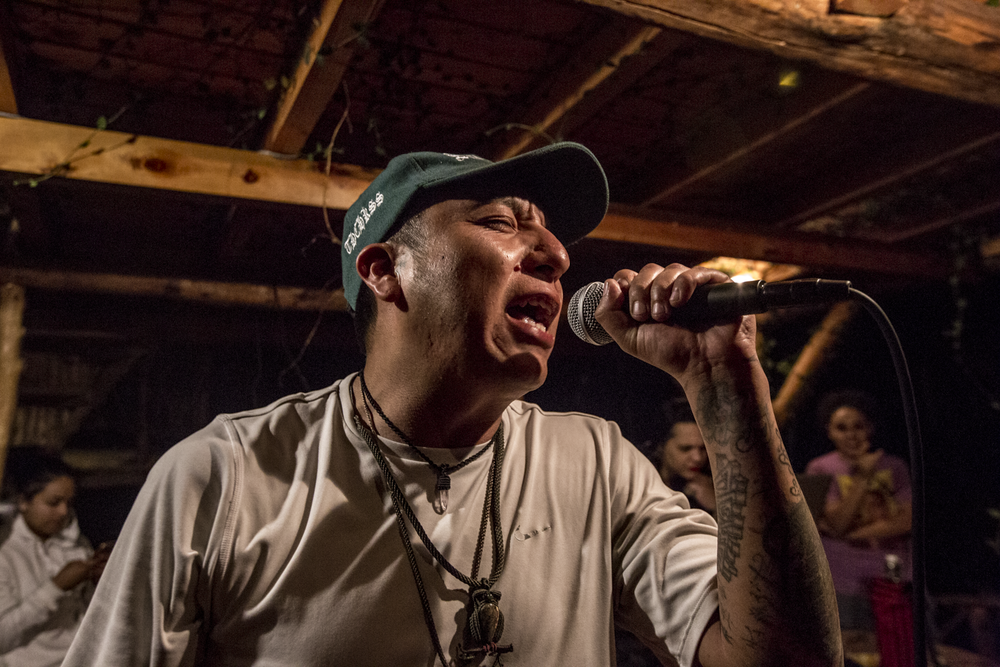 """Sergio Lopez """"CHKSS"""" sings passionately during a freestyle session in San Marcos La Laguna, Lake Atitlán on November 26, 2018."""