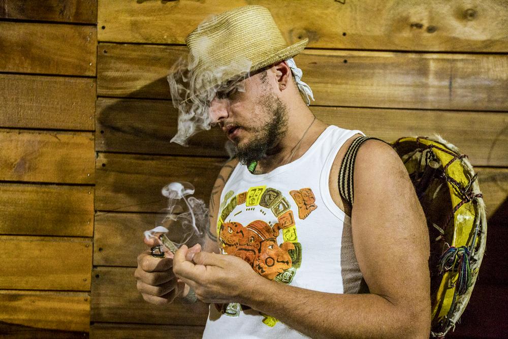 "Juan Martinez ""Dr. Nativo"" 37, from Balam Ajpu, smokes in his home in San Pedro La Laguna, Lake Atitlán, on December 9, 2018."
