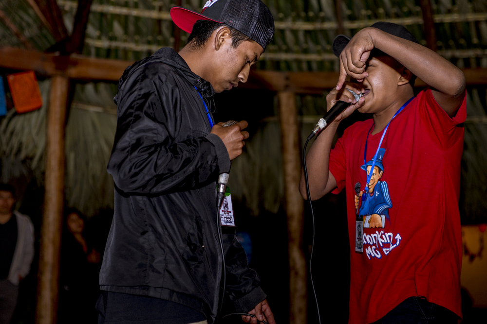 "Miguel Ixcaya ""Princsboys"" left, raps against Fresh Mc, during a freestyle competition group Juun Ajpu Koj, in San Marcos La Laguna, Lake Atitlán, on December 15, 2018."