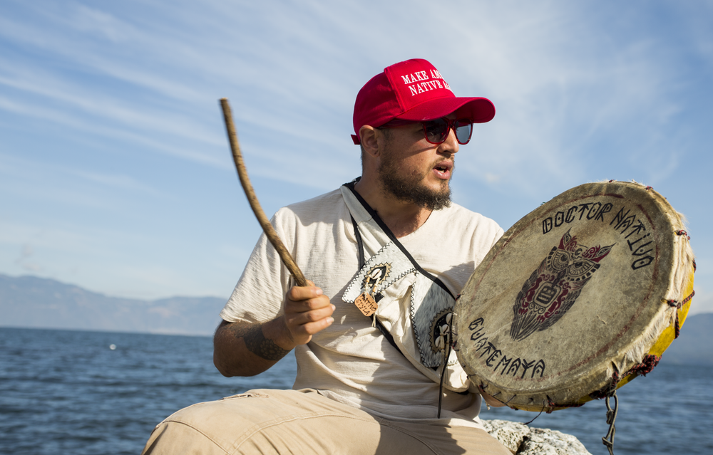 "Juan Martinez ""Dr. Nativo"" 37, from Bala Ajpu, plays a drum and sings in front of Lake Atitlán in San Pedro La Laguna on December 18, 2018."