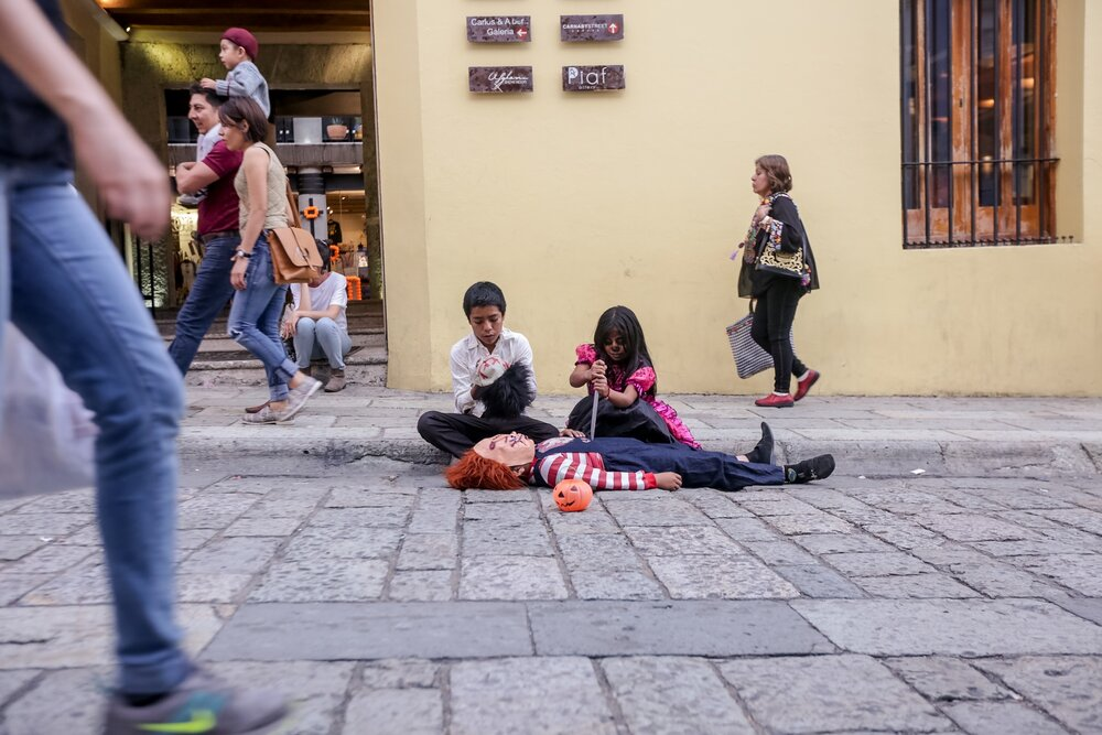 Kids play in the streets of Oaxaca, Mexico, during Día de Muertos (Day of the Dead) on October 30, 2018. Día de Muertos is a very special time in Mexico where people honor and celebrate the lives of their loved ones with activities, traditional food and costumes for a week.