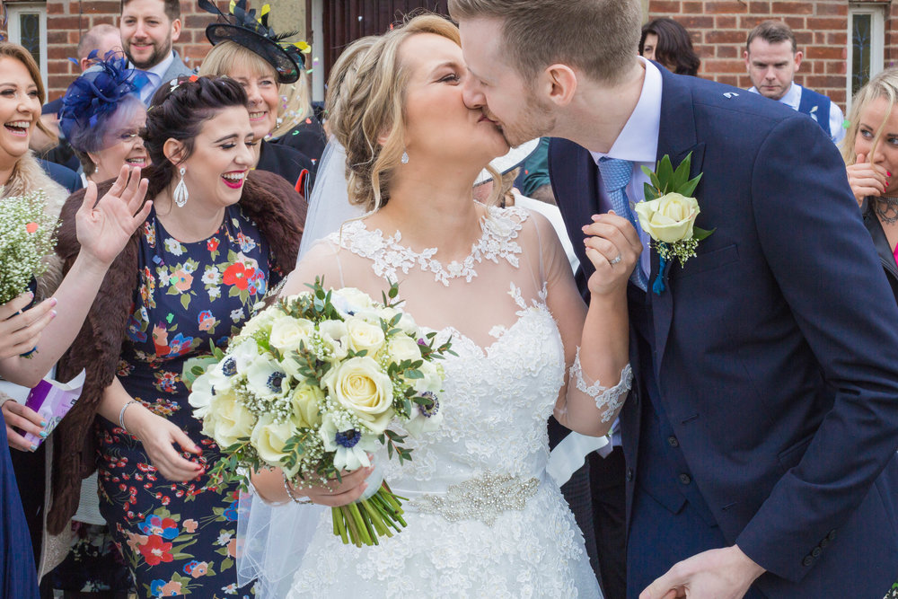 bride-and-groom-kissing-after-confetti-2.jpg