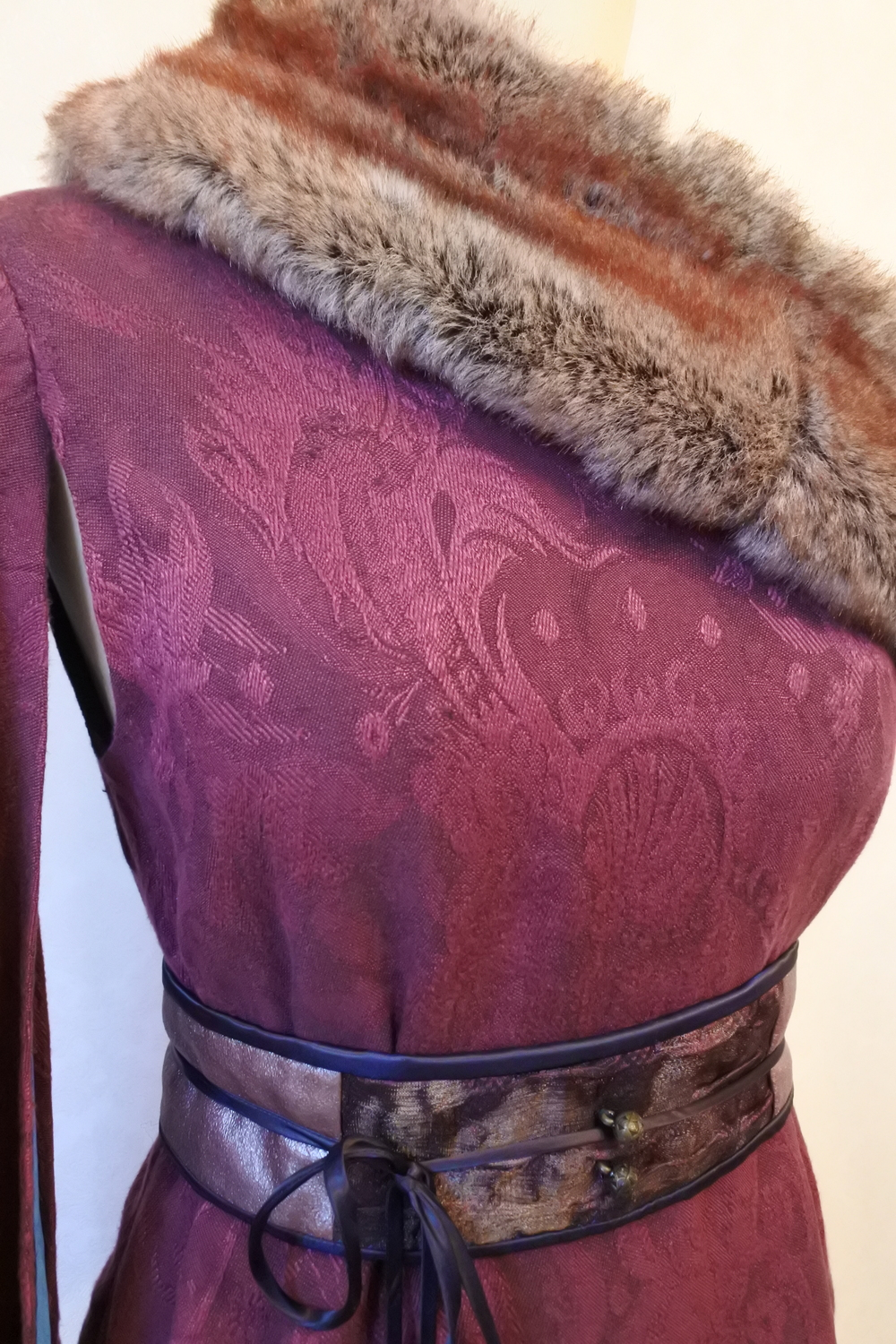 Fur collar and beaded waistband detail