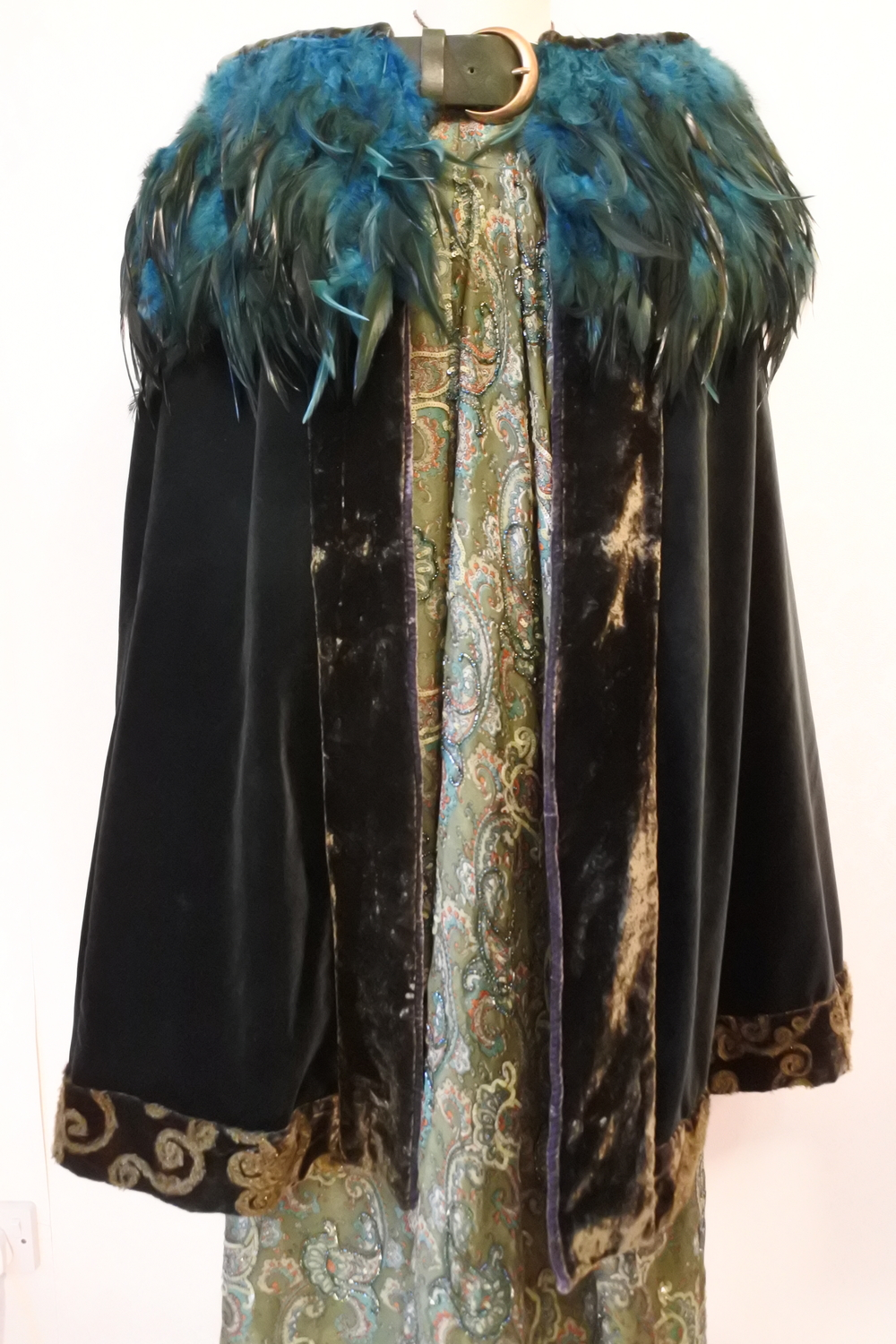 Emerald velvet cape with Celtic hem trim.