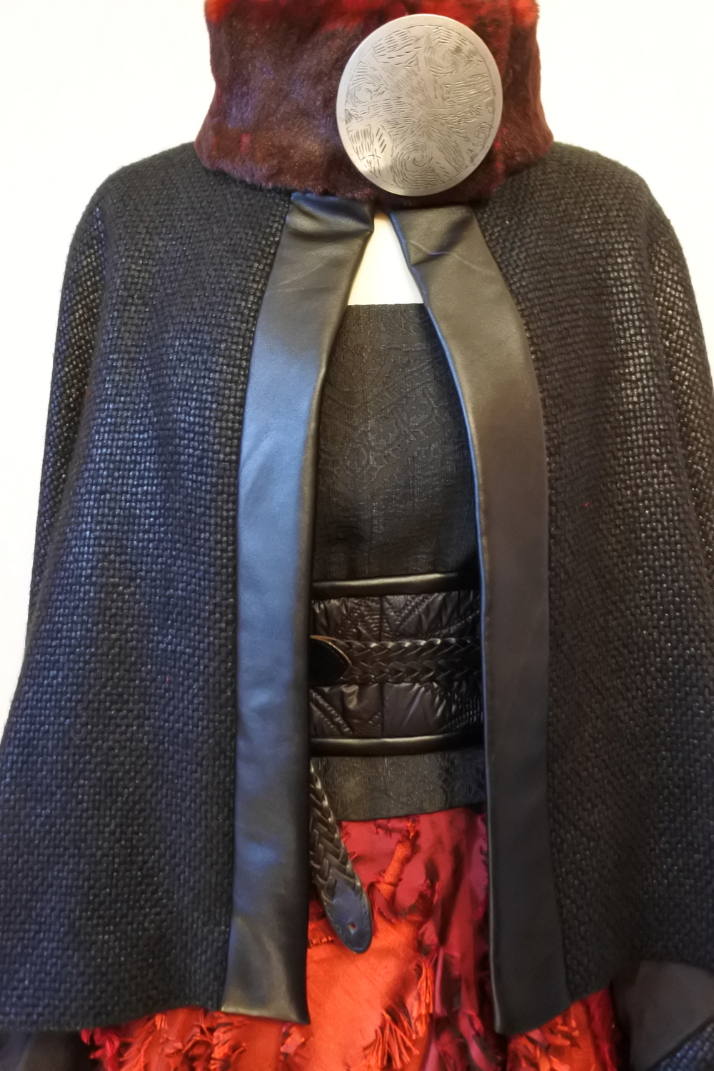 Silk lined wool cape with neck brooch and red fur collar.
