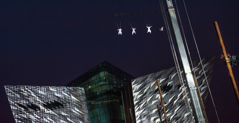 The Titanic Building, a stunning backdrop for the aerial performance.