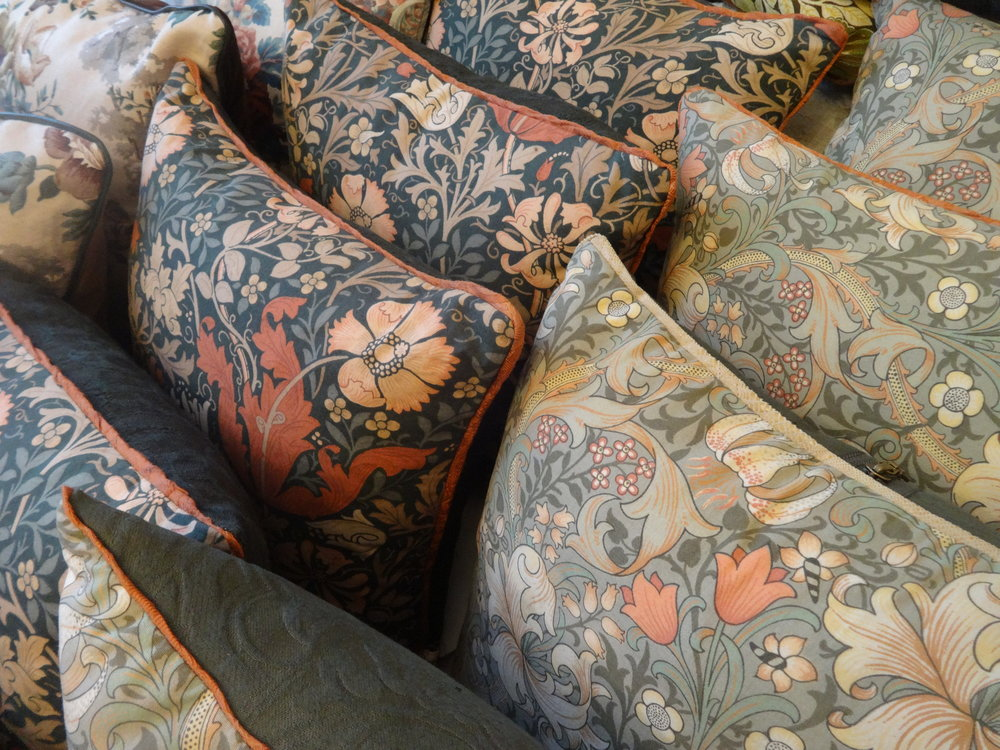 Hand made bias binding and piping make the colour pop in these William Morris cushions