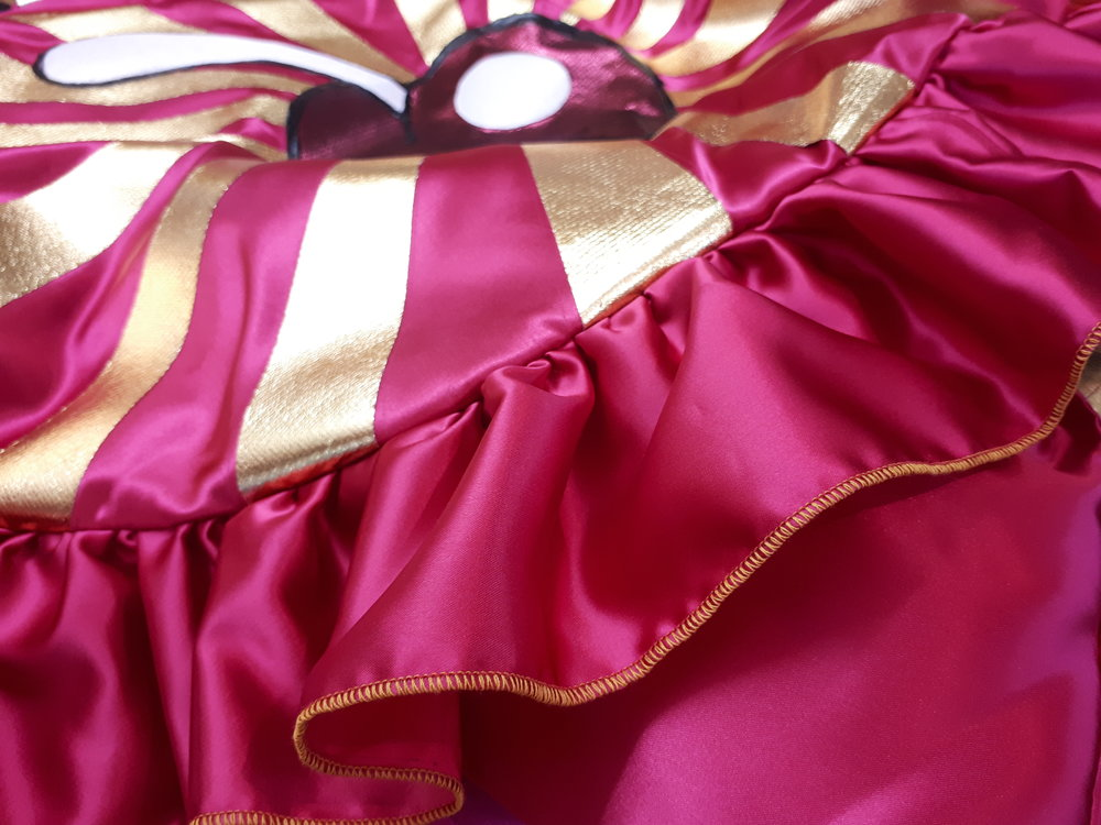 Gold and pink rolled frill hem.  Details are important to me