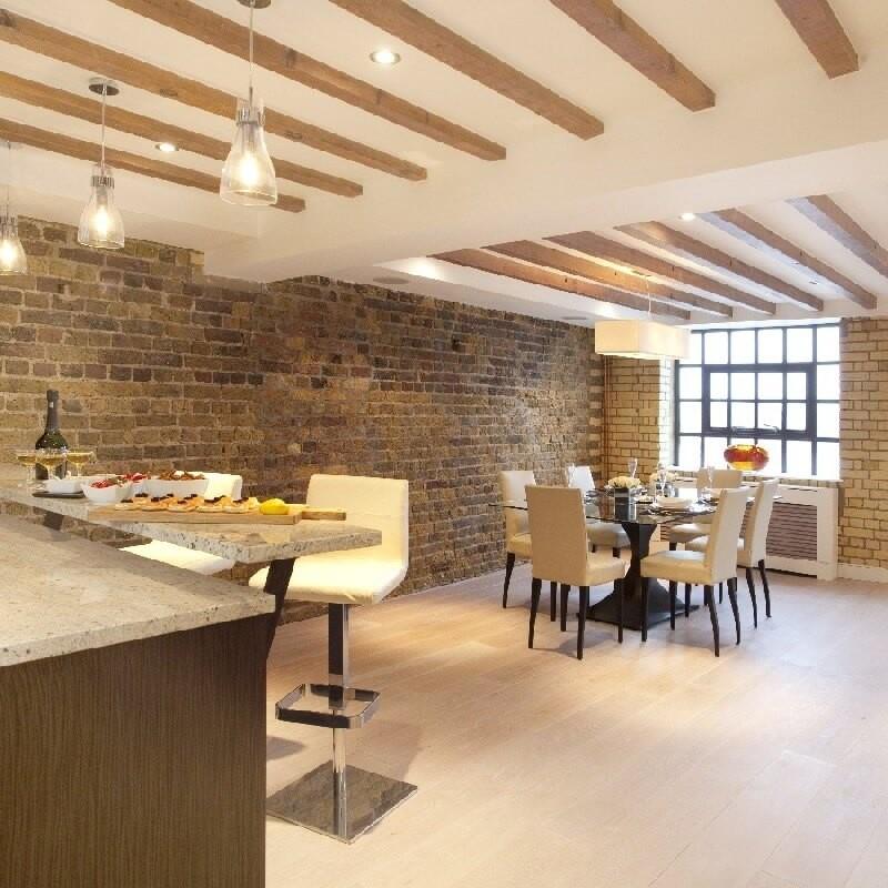 Contemporary Warehouse Interior Design Refurbishment. Brick walls, Wooden Beams. Bespoke Furniture and Kitchen.