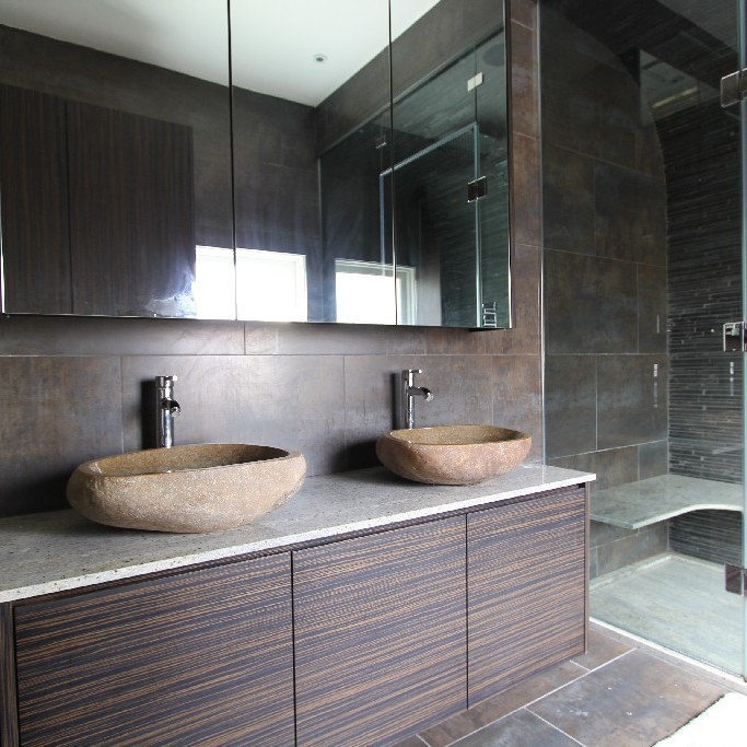 Luxury Natural Bespoke Bathrooms. Natural Elements. Stone. Slate. Marble. Italian Shower. Stone Basin. Wood Cupboard. Steam Room. Bright.