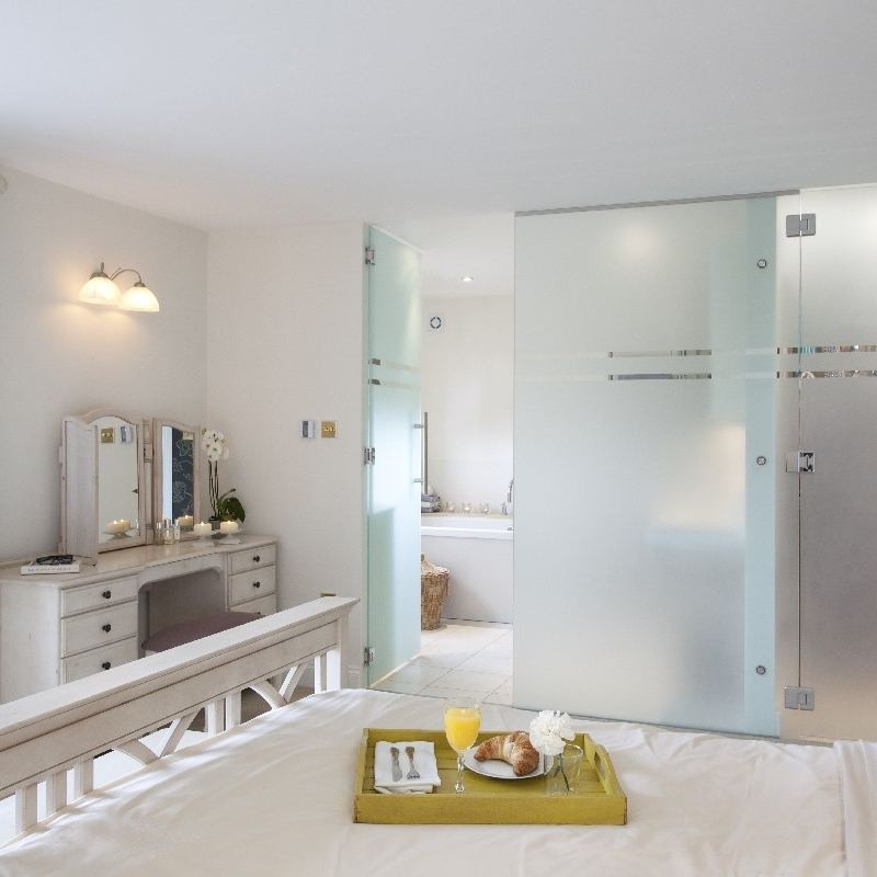 Luxury Bathroom. En-suite Room. Limestone Bathroom. Glass Panel. Light and Bright Bathroom. Bespoke Shower. Limestone Tray.