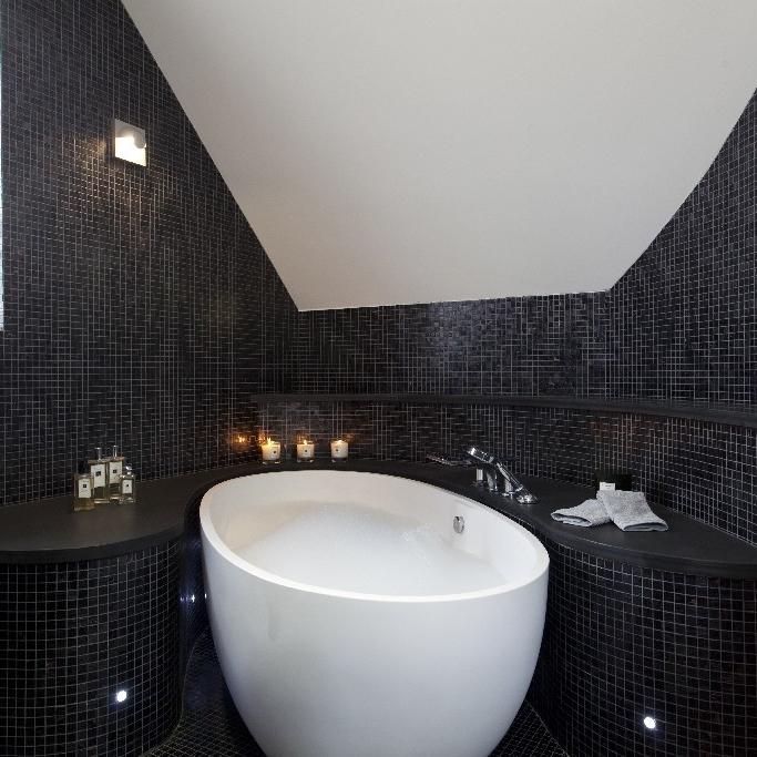 Luxury Bespoke Bathroom. Bath Area and Bespoke Glass Shower. Sauna. Steam Room. Macassar Ebony Wood. Bespoke Furniture. Slate.