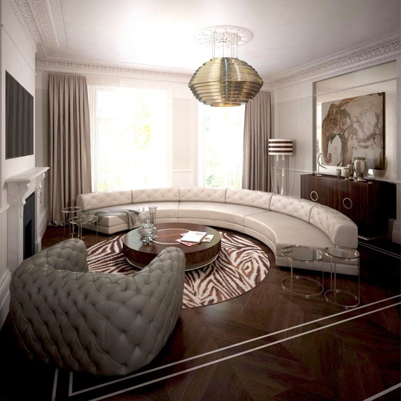 Luxury Interior Design. Wood Bespoke Furniture. Leather Family Sofa. Round Wood Coffee Table. Chester Moon Leather Sofa. Round Rug Zebra Pattern.