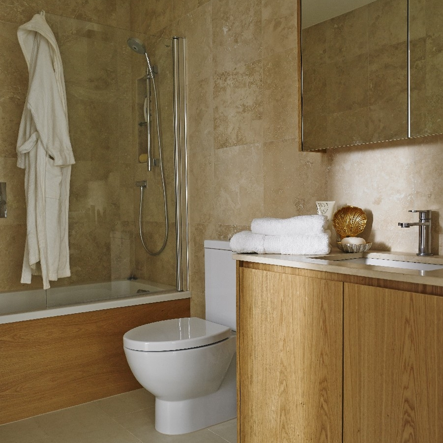 Luxury Interior Design Bathroom. Bespoke Furniture. Limestone. Wooden Bespoke Basin. Bath.