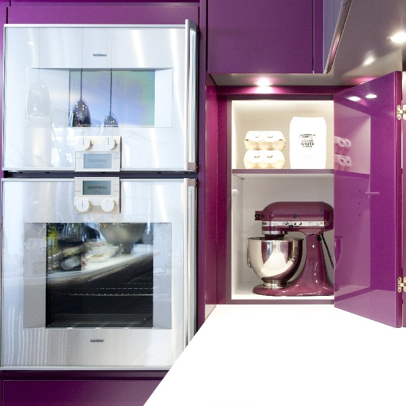 Modern Bespoke Kitchen. Macassar Wooden Island Cooking. Purple Glass Splashback. Brick Wall. White Worktops. Interior Design Kitchen. Bespoke Furniture. Purple Lacquer.