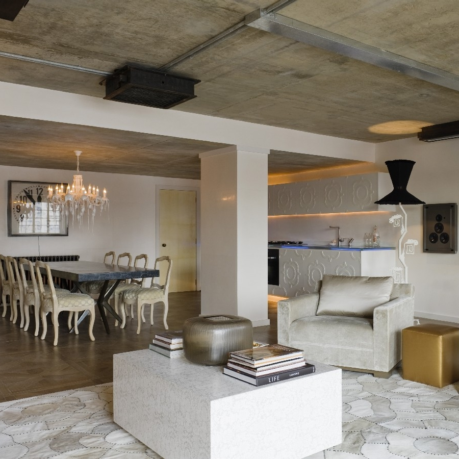 Luxury Interior Design. Bespoke Furniture. Highest Quality Finishes. Luxury Warehouse Design. Open Plan. David Carter Design. Large Marble Dinning Table. White Lacquer Kitchen.
