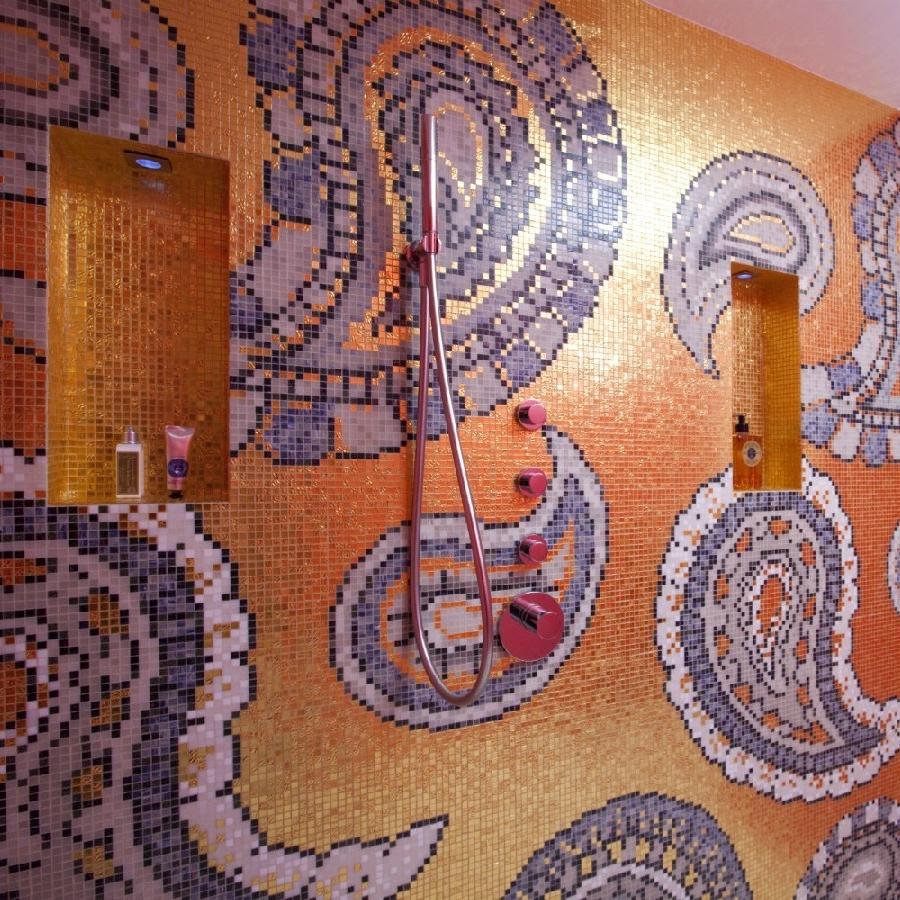 Luxury Interior Design. Bespoke Furniture. Highest Quality Finishes. Luxury Warehouse Design. David Carter Design. Bespoke Shiny Bathroom. Shiny Colourful Mosaic. Large Shower.