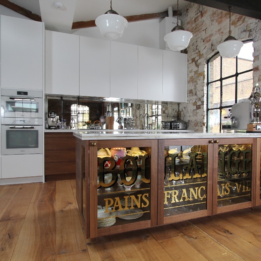 Bespoke Interior Design Kitchen. French/Vintage Style. Besppoke Walnut Furniture. White Marble Worktops. White Lacquer Cupboard. Mirror Splash Back. Brick Walls. Wood Floor.