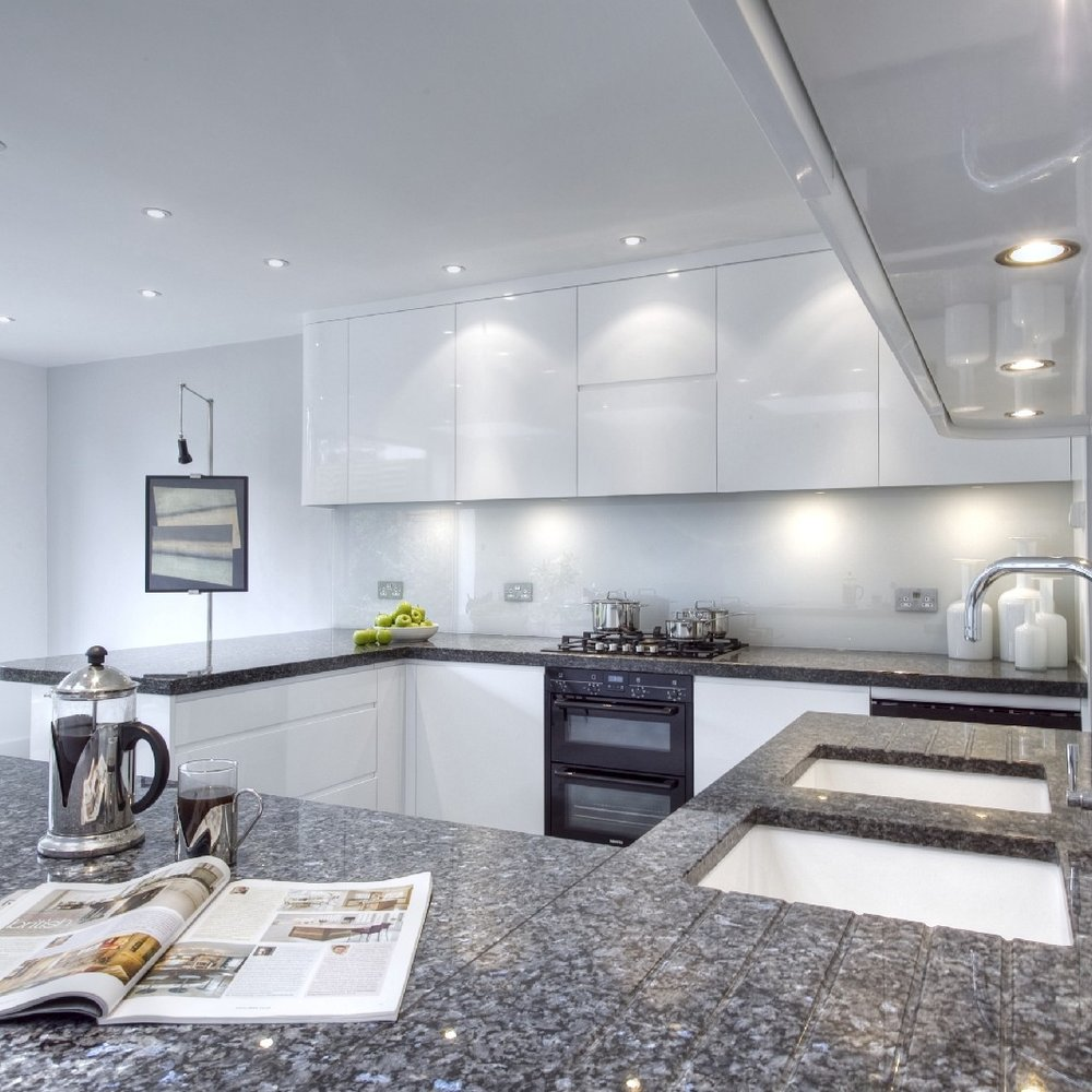 Modern/Contemporary Interior Design Kitchen. Bespoke Kitchen. Open Plan. White Lacquer. Blue Granite. Large sociable Kitchen. Light Grey Tiles.
