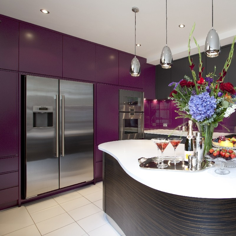 Modern Bespoke Kitchen. Macassar Wooden Island Cooking. Purple and Grey Lacquer. Purple Glass Splash Back. Brick Wall. White Tiles. White Worktops.
