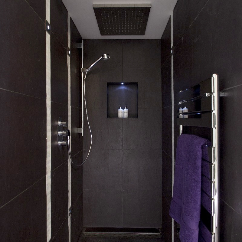 Luxury Bathroom. Bespoke Italian Shower. Stale Shower. Dark Tiles. Gentle Light.
