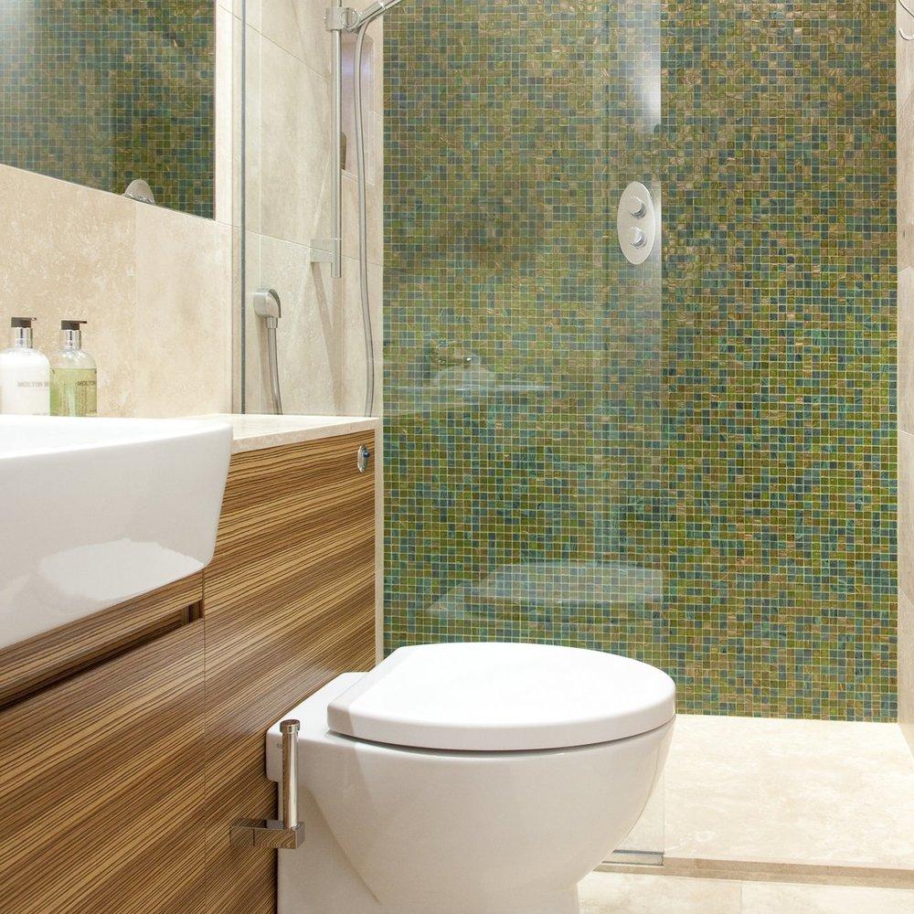 Luxury Bathroom. Bespoke Guest Bathroom. Bespoke Furniture. Blue/Green Mosaic. Italian Shower. Limestone Wall and Floor. Zebrano Cupboard.