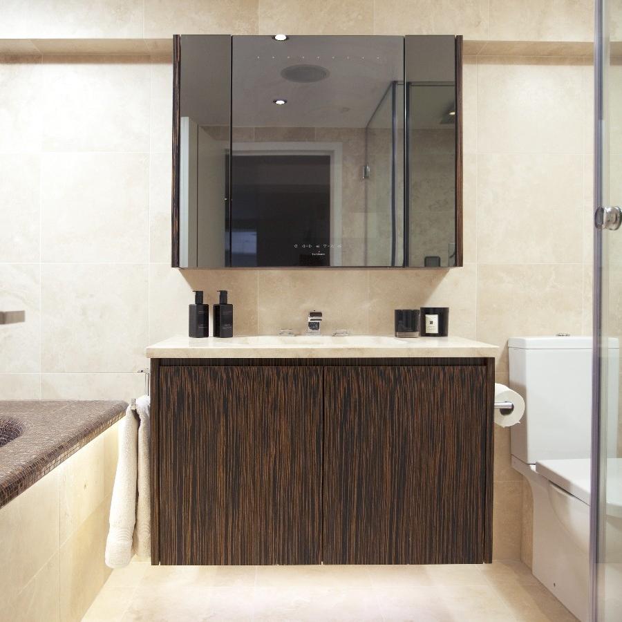 Luxury Bathroom. Bespoke Bathroom Furniture. Macassar Wood Cupboard. Bespoke Basin. Limestone.