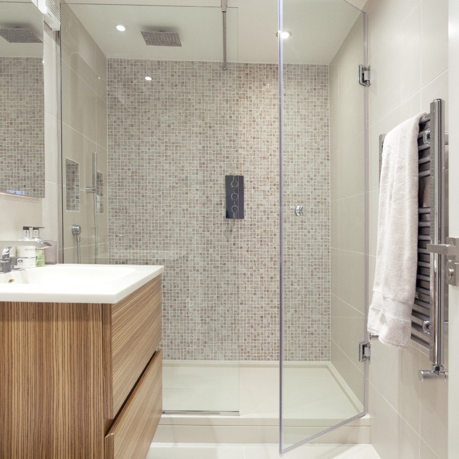 Luxury Bathroom. Bespoke Guest Bathroom. Light Tiles. Bespoke Basin. Wood Cupboard. Large Glass Shower.