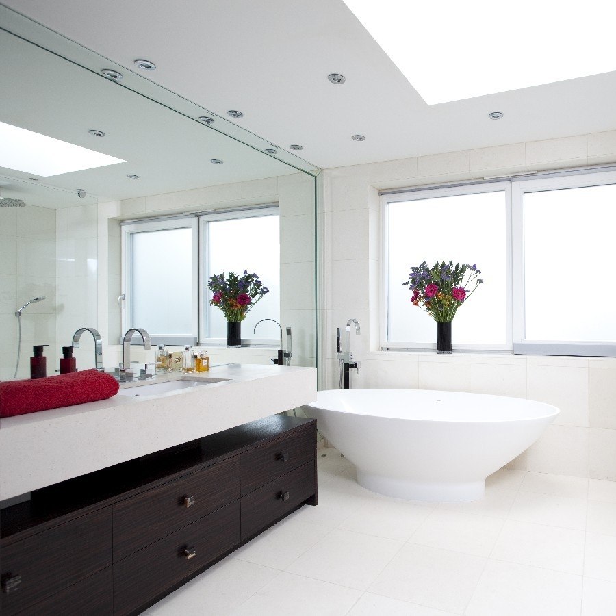 Luxury Bathroom. Large Walled Mirror. Frame Mirror. Macassar Bespoke Cupboard. Freestanding Bath. Limestone Wall and Floor.