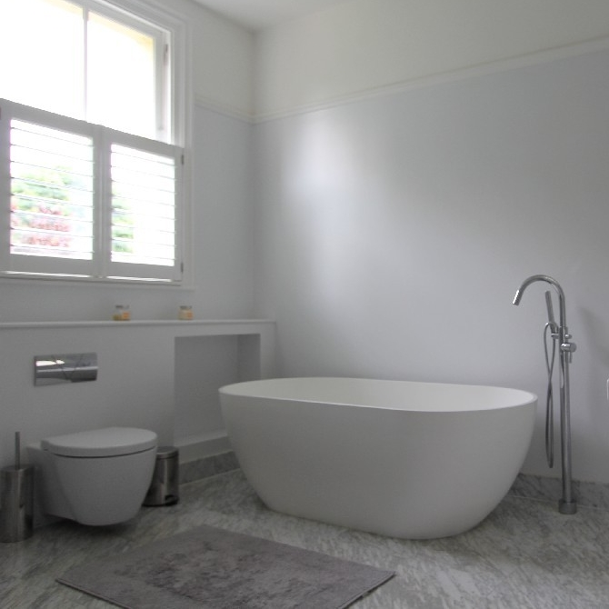 Large Bright Bespoke Bathroom. Freestanding Bath. Marble Floor.